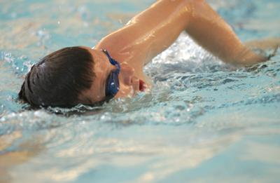 Swimmer in campus swimming pool