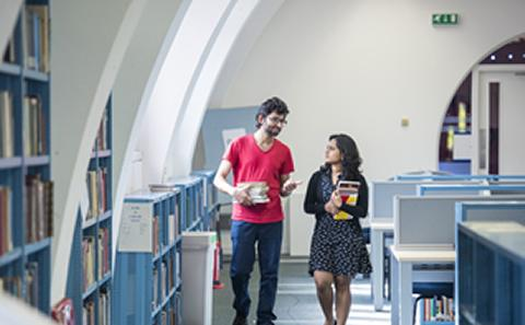 Students walking in the library