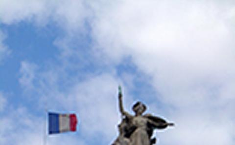French flag and statue
