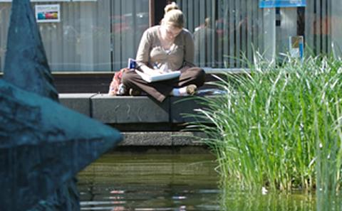 Student on a laptop outside