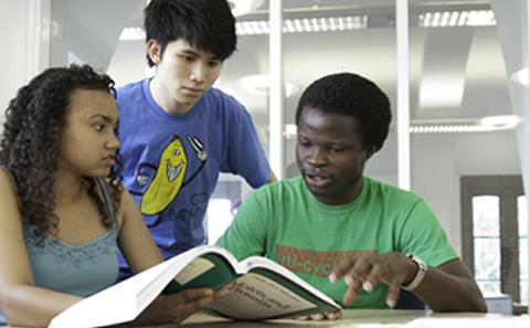 Three students reading together