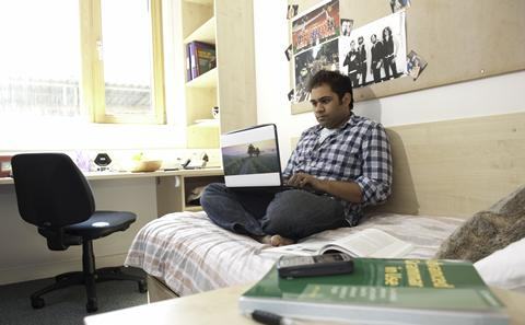 Student studying in their room