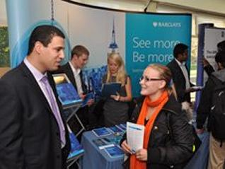 Employer speaking with a student at a career fair