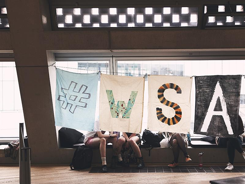 WSA students with sign at Tate Exchange