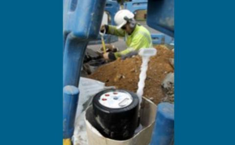 A worker installing water-meter