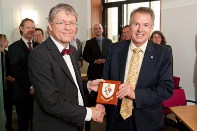 A University shield being presented