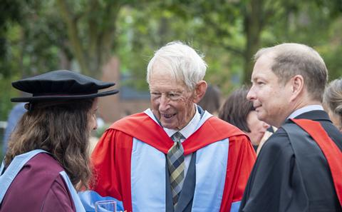 Sir Anthony Laughton greets student