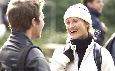 Woman in hat smiling at man