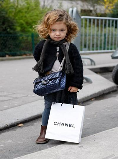 Child with a Chanel bag