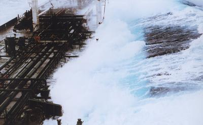 Wave hitting tanker. Credit: NOAA