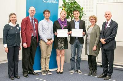 Winners standing with certificates