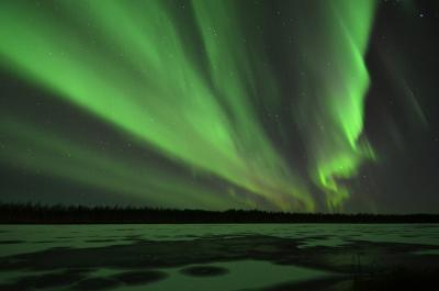Aurora over river Kitinen, Finland