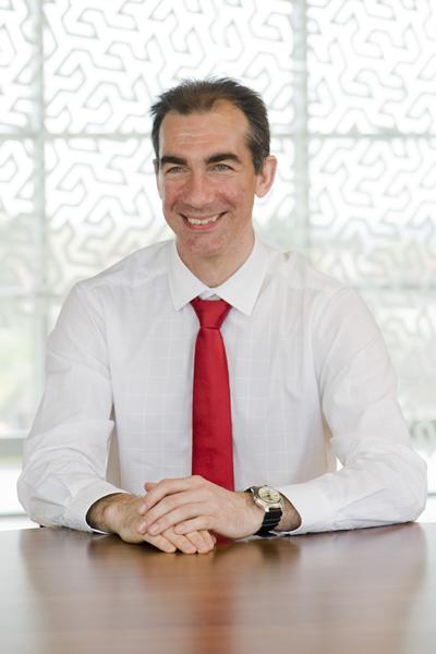 James Wilson sitting at a desk