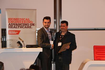Joshua collecting his award