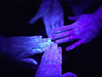 UV germ training lotion on hands