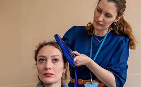 Valerie Brandt using lab equipment
