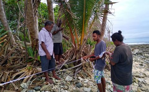 Measuring shoreline Fanalei Island