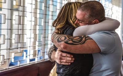 Prisoner hugging loved one