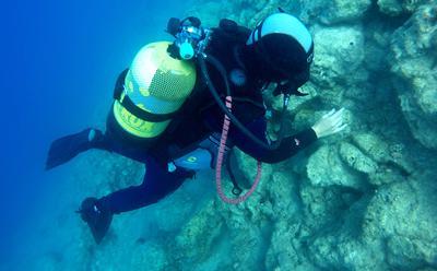 Diver in Roman marble quarry.