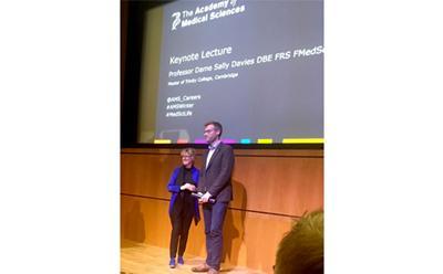 Dr Matt Loxham receives his award