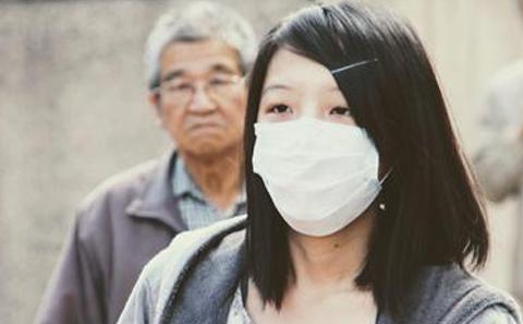 Chinese woman in mask