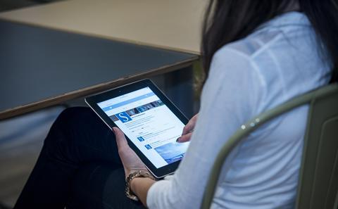 Student looking at an ipad