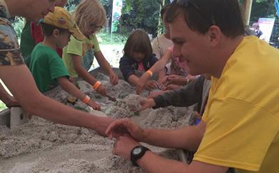 Children explore the river sandbox