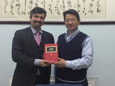 Professors holding book