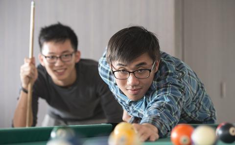 Two men playing snooker