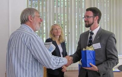 Dr Craig Dolder receiving award
