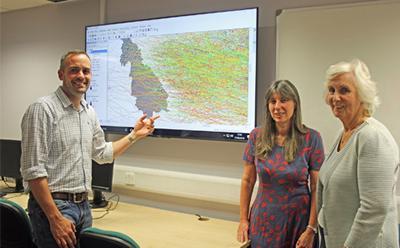 GIS staff around new screen
