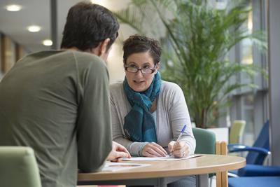Student talking with an advisor