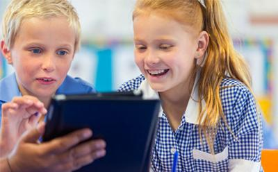 School kids looking at a tablet