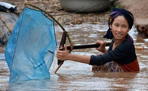 Working on the Mekong River
