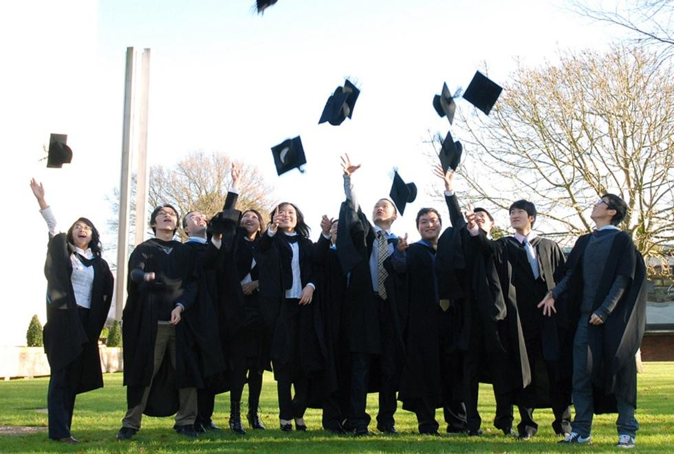 Photo of students celebrating at winter graduation