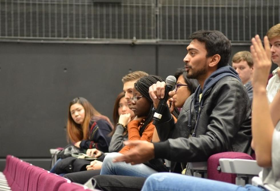 Students asking questions at the first forum