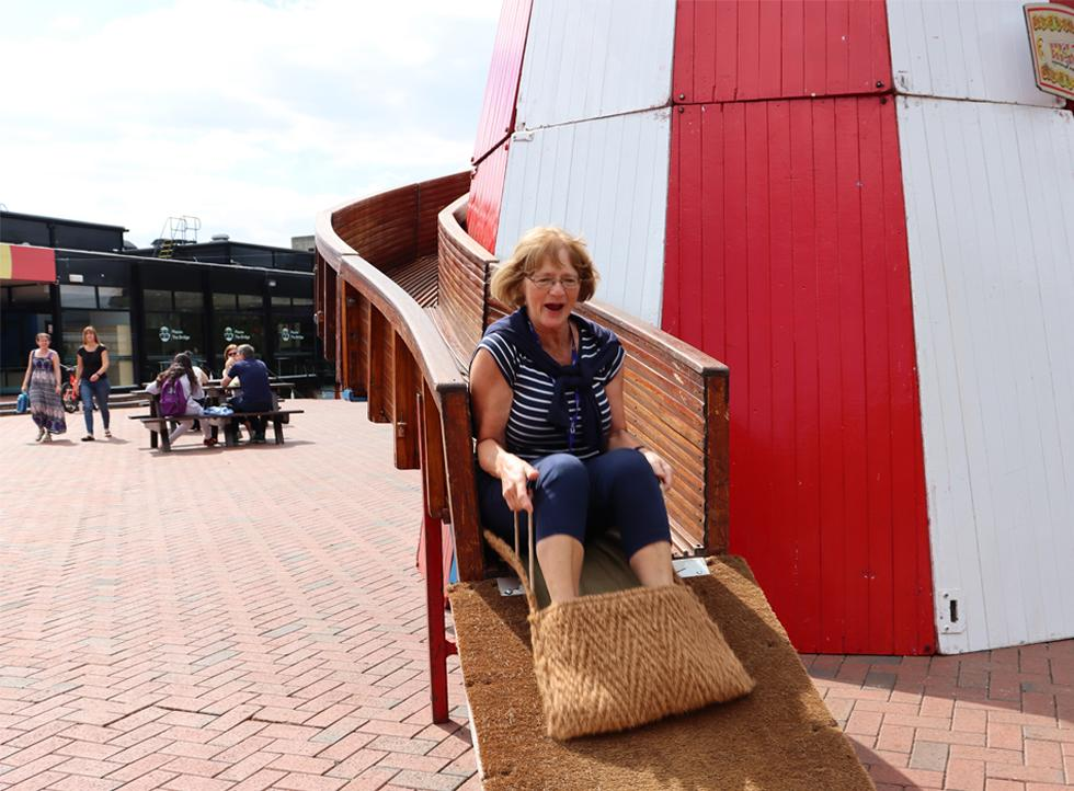 A member of staff having fun on the Helter Skelter