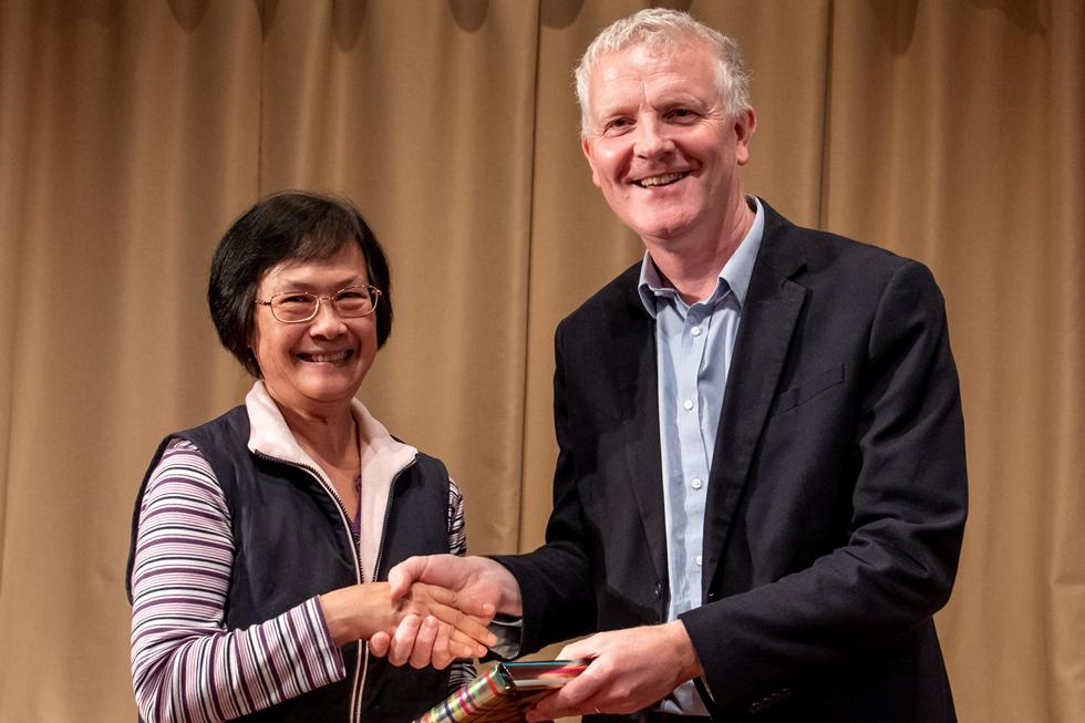 Jenny Lee accepting the prize on behalf of her daughter Joyce Lee