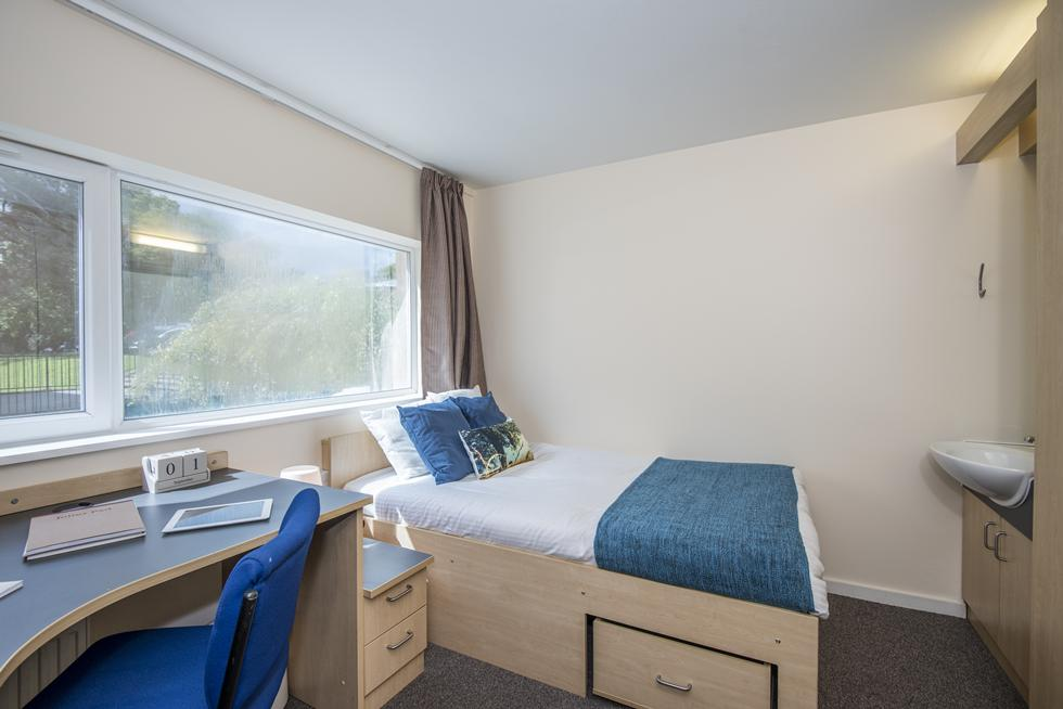 An example of a newer non-en suite category 2 room with a small double bed