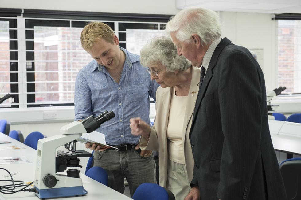Laboratory technician Tom Bishop demonstrates equipment