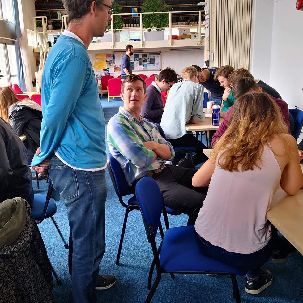 Dr. Andreas Schmitt chatting with students