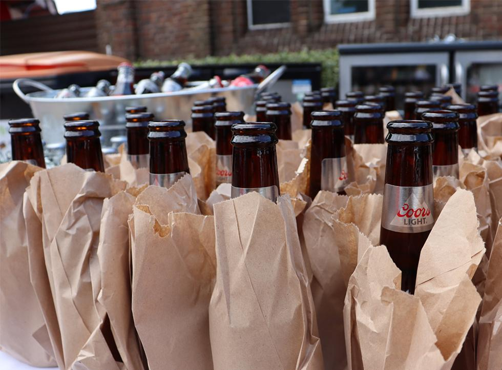 Beer bottles in vintage brown bags