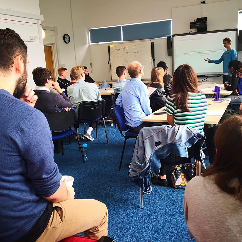 Dr. Andreas Schmitt giving a talk on academic careers