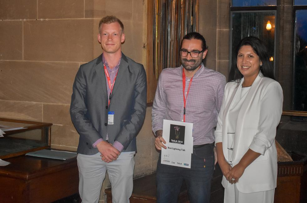 Orestis receiving his award from Symposium's Chair Dr Farah Ahmed