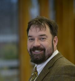 Dr Neil J Gostling