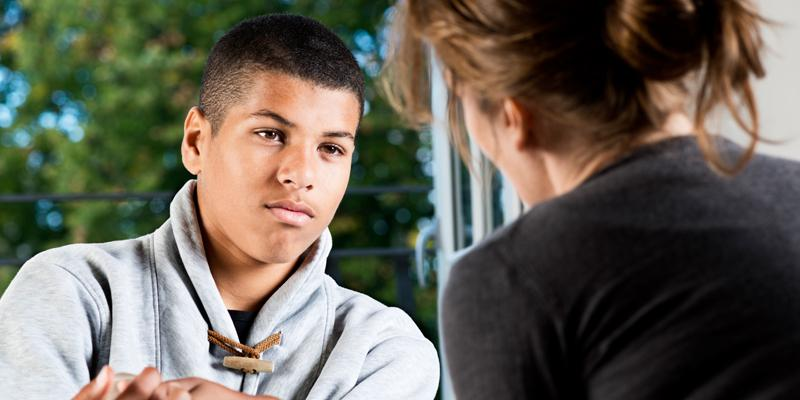 Child with mental health professional during consultation